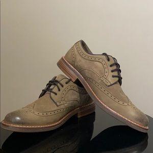 Tan wingtip shoes